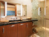 12remodeled-tropical-maui-guest-bathroom-shells-monstera-leaf